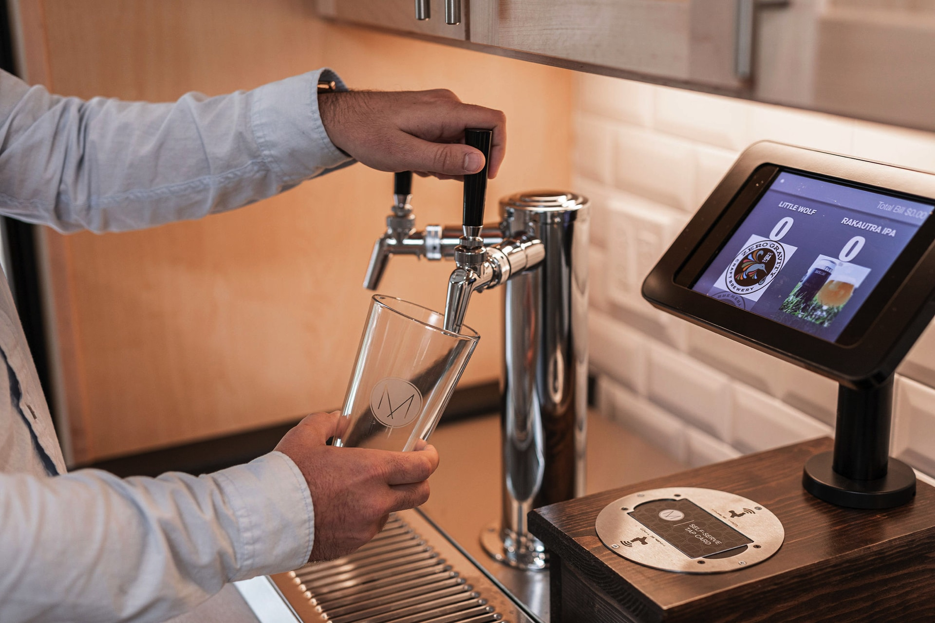 Self-serve beer and hard cider selection in community room